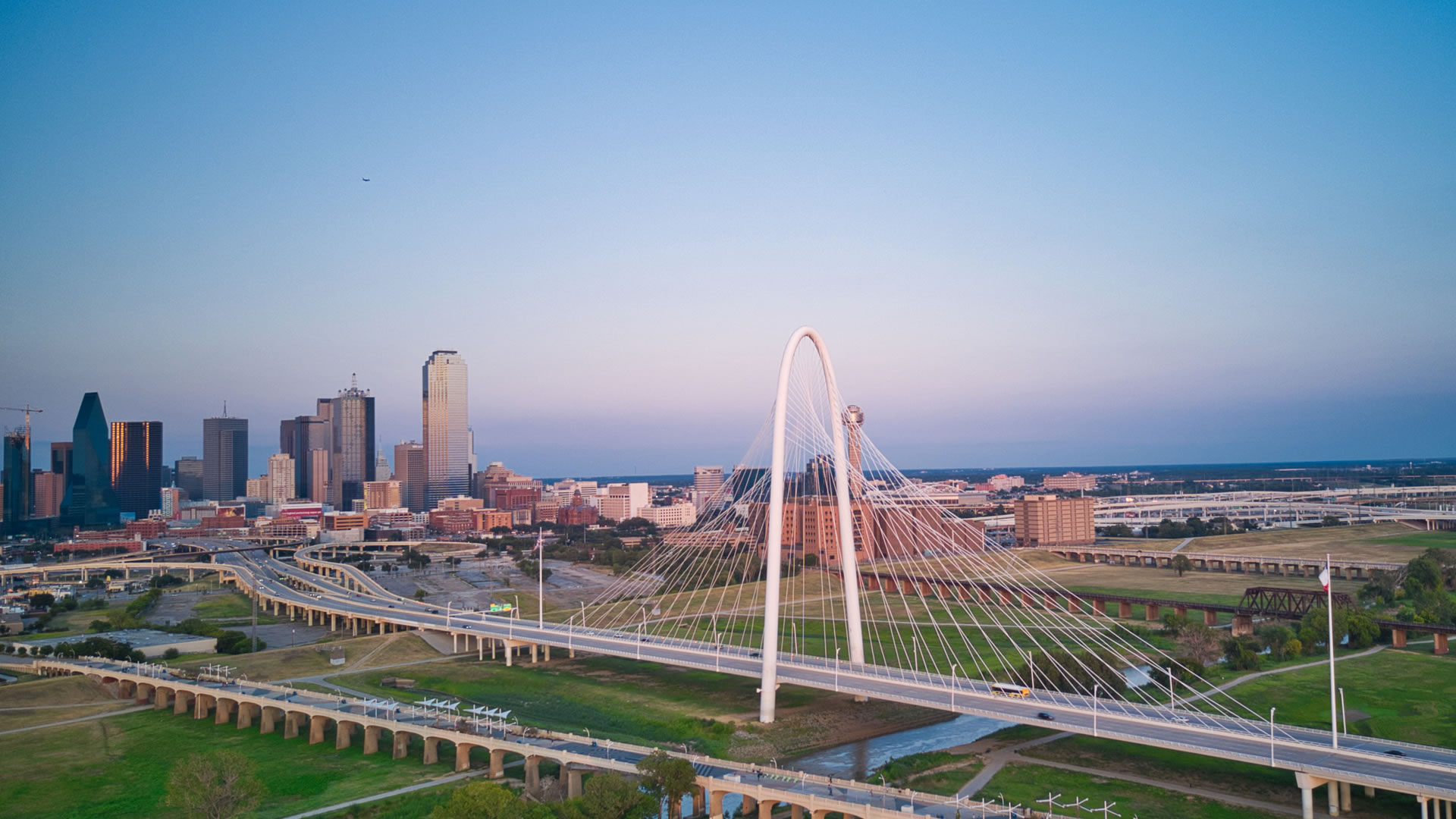 The Margaret Hunt Hill Bridge is designed by internationally renowned architect Santiago Calatrava. This stunning bridge with a 400 foot center arch connects Woodall Rodgers Freeway seamlessly to Singleton Boulevard in West Dallas.