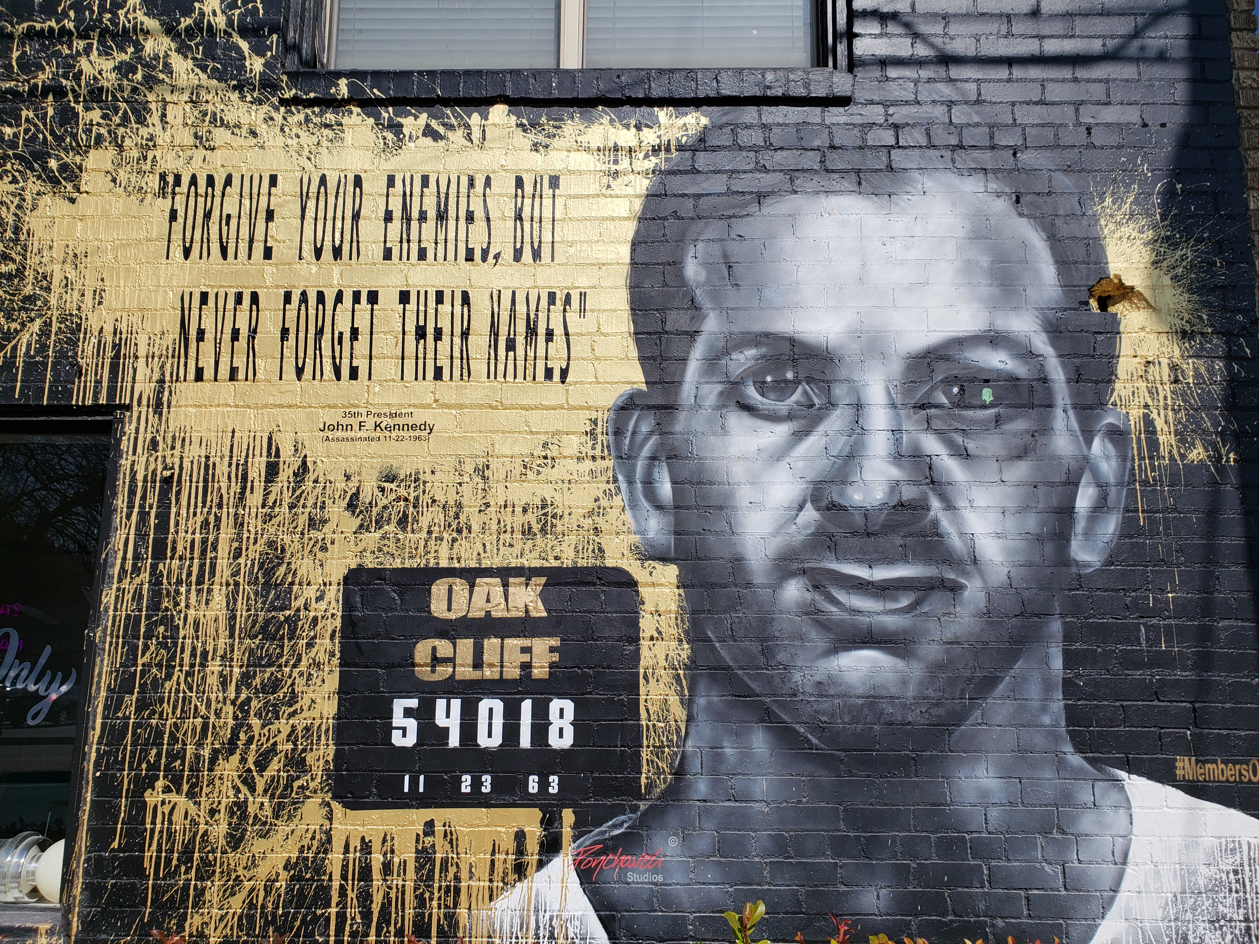 The Members Only barbershop in Oak Cliff now features a black and white portrait of Oswald on the side of the building at West 7th Street and North Madison Ave.