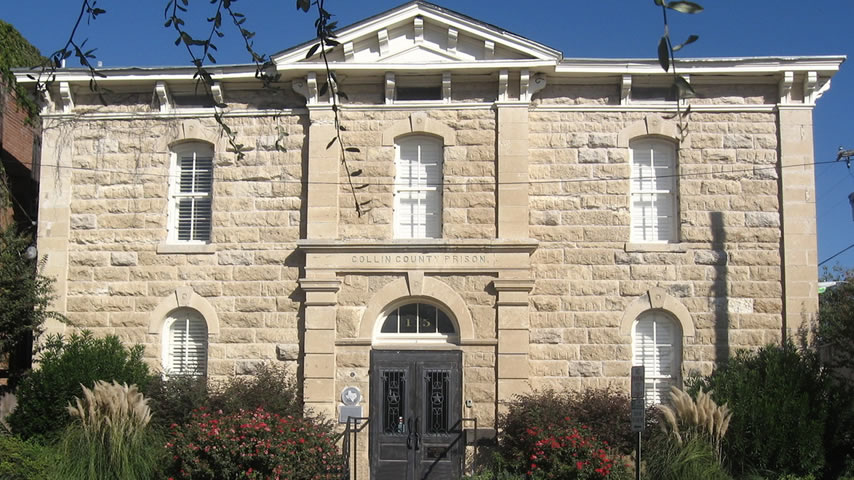 The Old Collin County Prison is one of Texas' oldest nineteenth-century county jails substantially in original condition. It is a Victorian Italianate structure designed by Austin architect F. E. Ruffini. The prison, completed in 1880, is constructed of rough-cut blocks of fossilized limestone quarried at Squeeze Penny.
